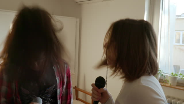 teenage girls singing to the music and head banging - head banging stock videos & royalty-free footage