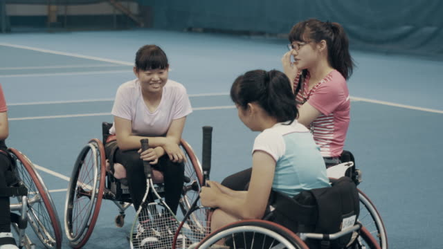 teenage girls taking a break from playing wheelchair tennis - disability stock videos & royalty-free footage