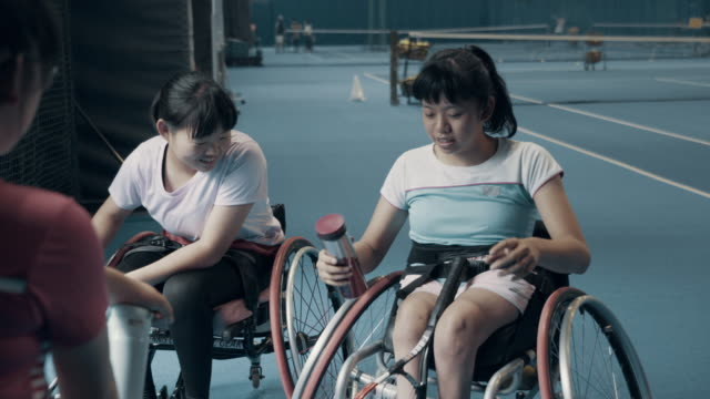 teenage girls taking a break from playing wheelchair tennis - persons with disabilities stock videos & royalty-free footage