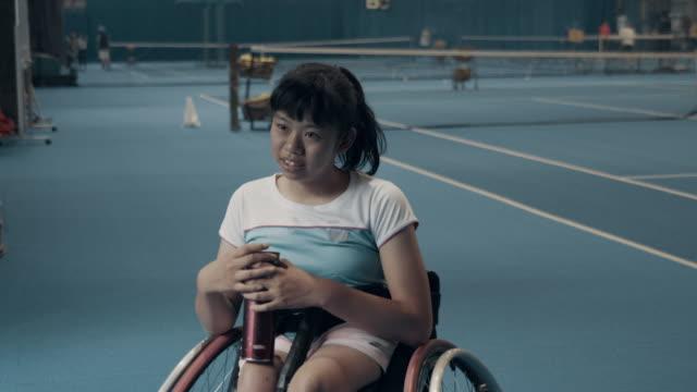 teenage girls taking a break from playing wheelchair tennis - paraplegic stock videos & royalty-free footage