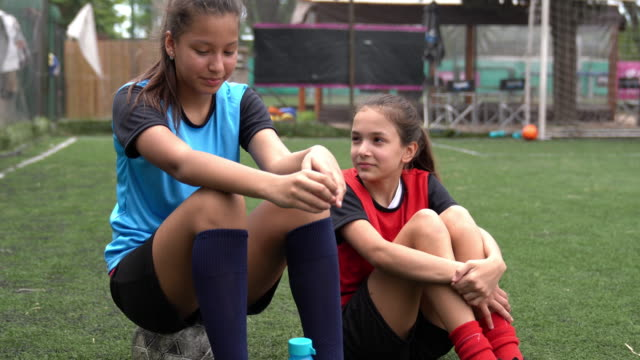 teenage girls talking on soccer field - sports team stock videos & royalty-free footage