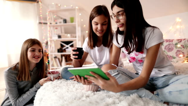 teenage girls using a digital tablet - slumber party stock videos and b-roll footage