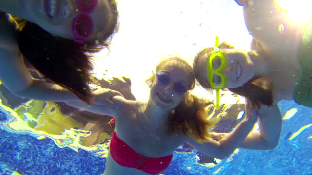 teenage girls with goggles looking underwater - swimming goggles stock videos & royalty-free footage