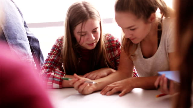 teenage girls working in school together - england stock videos & royalty-free footage