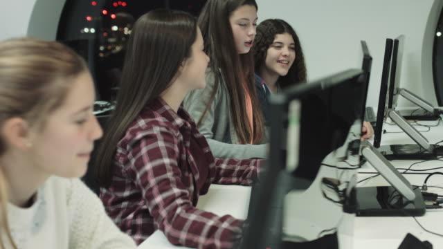 Teenage girls working on computer