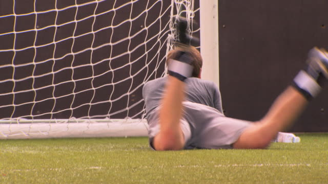 ms pan teenage (16-17) goalkeeper making save, london, uk - one teenage boy only stock videos & royalty-free footage