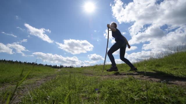 teenage hiker girl jumping in beautiful meadow - joy stock videos & royalty-free footage