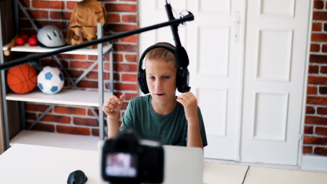 teenage influencer with headphones recording daily vlog - tutorial stock videos & royalty-free footage