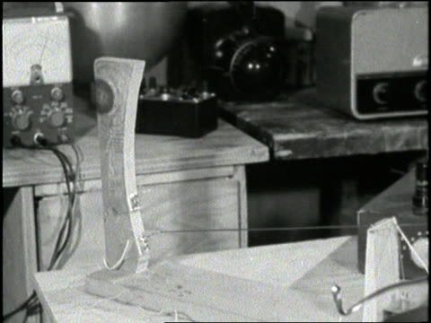 teenage inventor victor scheinman speaks into a microphone to demonstrate the electro mechanical voice inscriber - 発明家点の映像素材/bロール