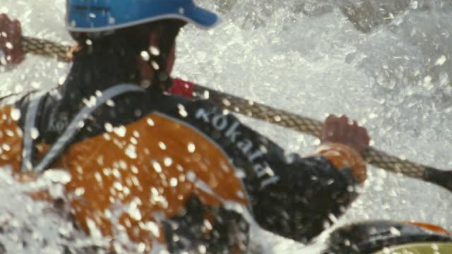 vídeos de stock, filmes e b-roll de slo mo cu teenage kayaker swimming in river rapids, glenwood springs, colorado, usa - só um menino adolescente
