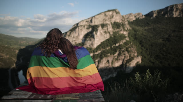 teenage lesbians having fun after long hike - rainbow flag stock videos & royalty-free footage