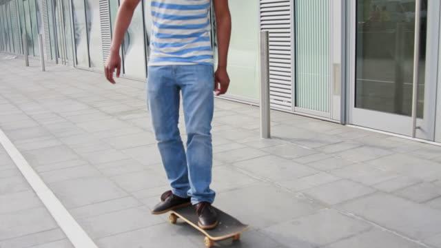 Teenage male skateboarding