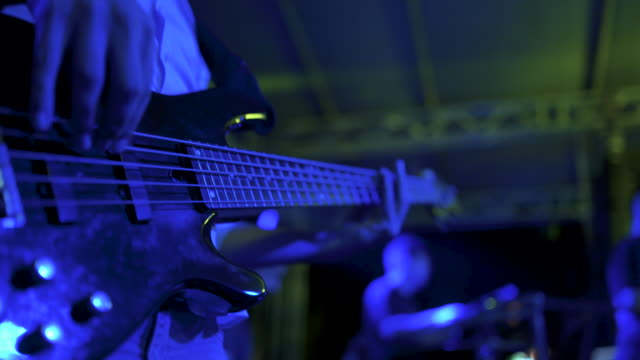 teenage man playing the bass guitar stock video - musician stock videos & royalty-free footage