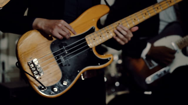 teenage man playing the bass guitar - bass guitar stock videos & royalty-free footage