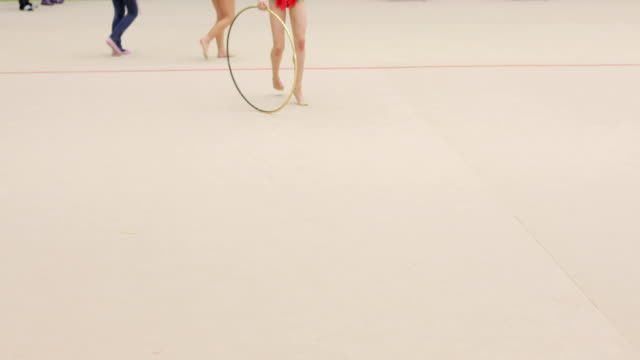 Teenage Rhythmic Gymnastics Athlete Failing at Practice