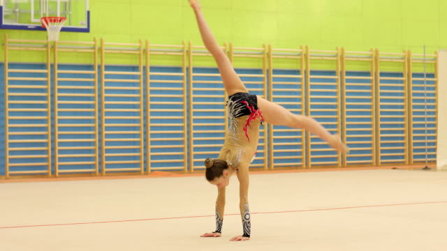 Teenage Rhythmic Gymnastics Athlete Practicing