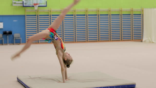 Teenage Rhythmic Gymnastics Athlete Practicing with Ball