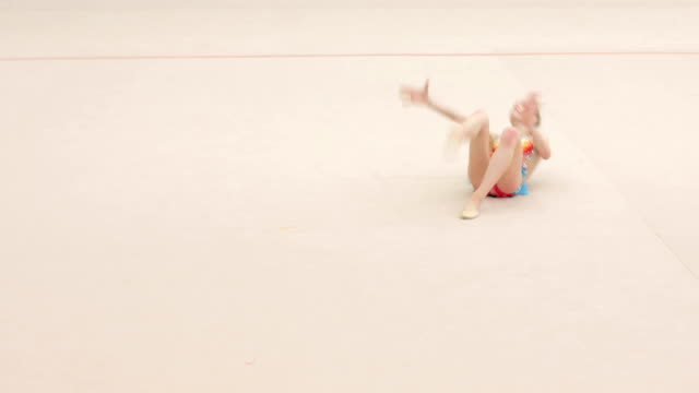 teenage rhythmic gymnastics athlete practicing with cool attitude - fallimento video stock e b–roll