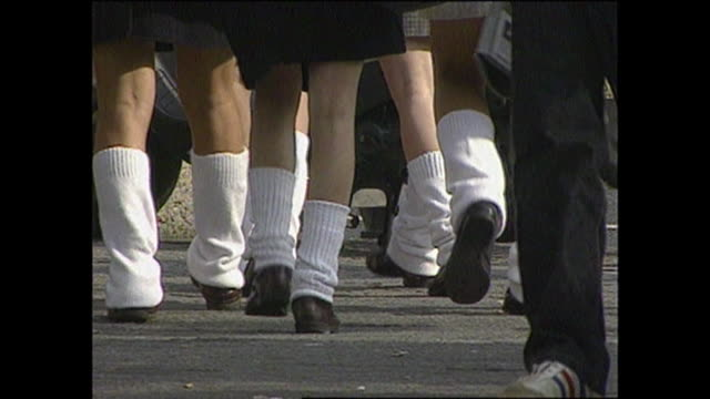teenage school girls wear extremely baggy white socks called loosesocks with a school uniform / it was one of the fashion style for women in japanese... - japanese school uniform stock videos & royalty-free footage
