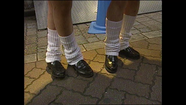 teenage school girls wear extremely baggy white socks called loose-socks with a school uniform. / it was one of the fashion style for women in... - sock stock videos & royalty-free footage