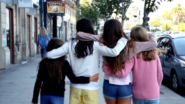 vídeos de stock, filmes e b-roll de teenage sisters and friends hanging out together on the street. - 12 13 anos