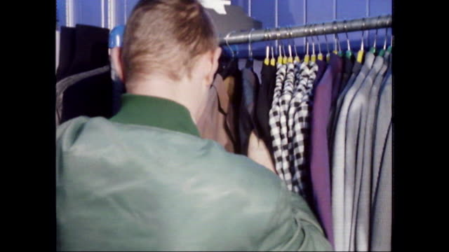 teenage skinhead boys shop for clothes; 1980 - one teenage boy only stock videos & royalty-free footage
