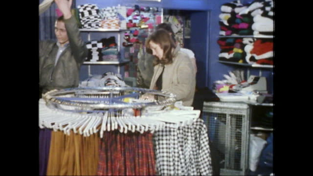 teenage skinheads shopping for clothes; 1980 - clothes shop stock videos & royalty-free footage