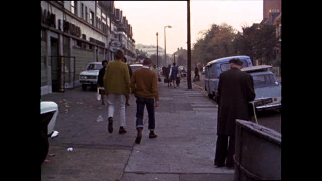 teenage skinheads walk down urban street; 1969 - adolescence stock videos & royalty-free footage