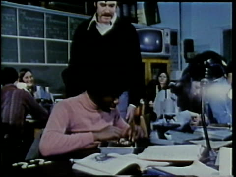 1972 montage teenage students in biology class dissecting frogs and using microscopes, arlington, virginia, usa / audio - scientific experiment stock videos & royalty-free footage