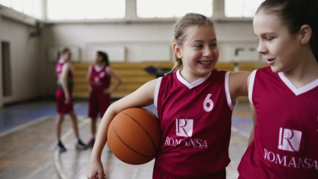 teenage teammates embracing - basketball sport stock videos & royalty-free footage