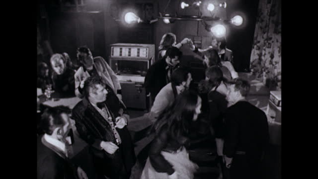 teenage teddy boys and girls dance in bar setting; 1974 - pop music stock videos & royalty-free footage