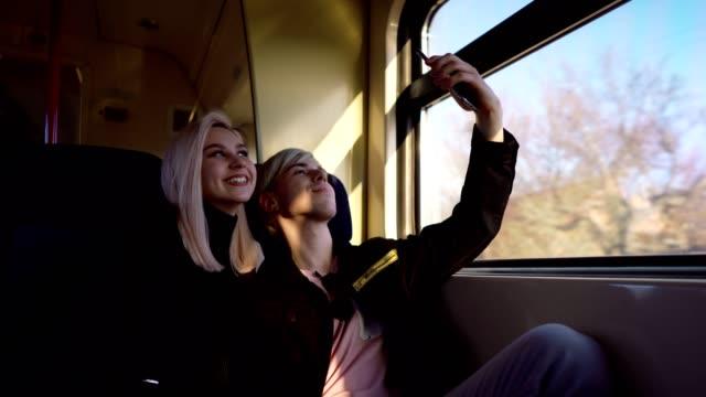 teenage travelers taking selfie - teenage couple stock videos & royalty-free footage