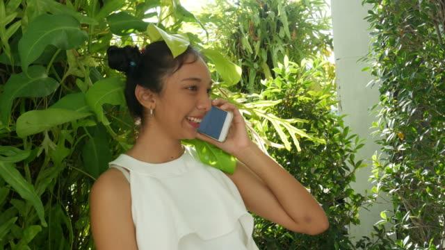 teenage woman using smart phone