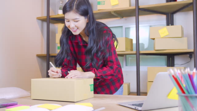 teenage women working at house shipping products, small business selling products online concept. - packing stock videos and b-roll footage