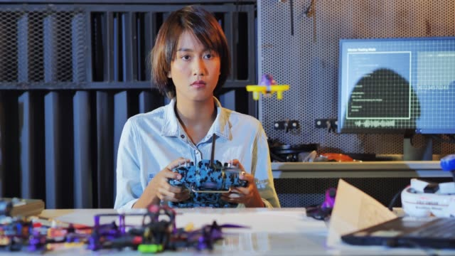 teenage women works on a fully functional programable robot for school robotics club project.creative designer testing robotics prototype in workshop.science concept.industry 4.0 - remote control stock videos & royalty-free footage