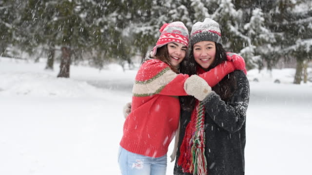 teenaged best friends playing outside in winter snow. - teenage girls stock videos & royalty-free footage
