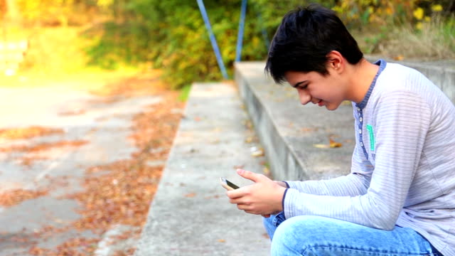 teenager boy  looking at phone