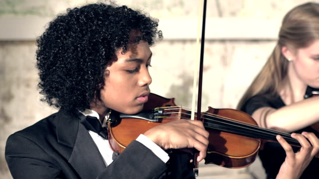 teenager boy playing violin in concert - violin stock videos & royalty-free footage
