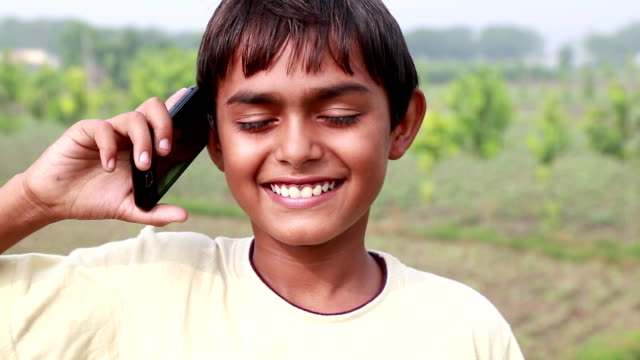 teenager boy talking on phone - geographical locations stock videos & royalty-free footage
