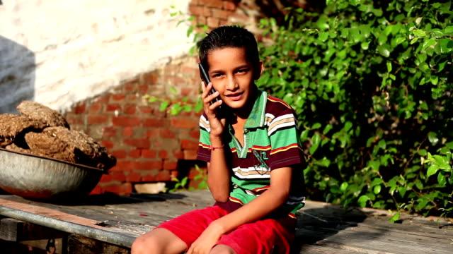 Teenager boy talking on Smartphone