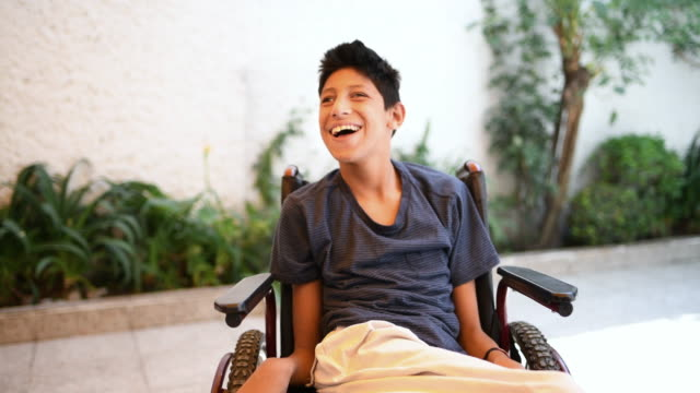 teenager boy with cerebral palsy - disability stock videos & royalty-free footage