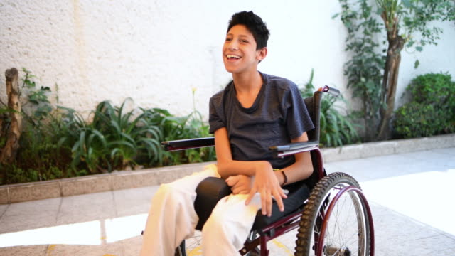 teenager boy with cerebral palsy - cerebral palsy stock videos & royalty-free footage