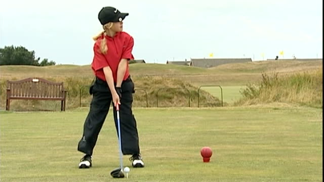 teenager charley hull tops ladies european tour earnings t02080639 / tx lythamstanne's charley hull teeing off on windy golf course - pga event stock videos and b-roll footage