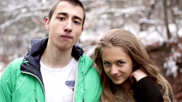 teenager couple posing and looking at camera - teenage couple stock videos & royalty-free footage