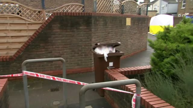 teenager dies following stabbing in chadwell heath; england: london: chadwell heath: ext close shot blue police cordon tape red police cordon tape on... - road closed englisches verkehrsschild stock-videos und b-roll-filmmaterial