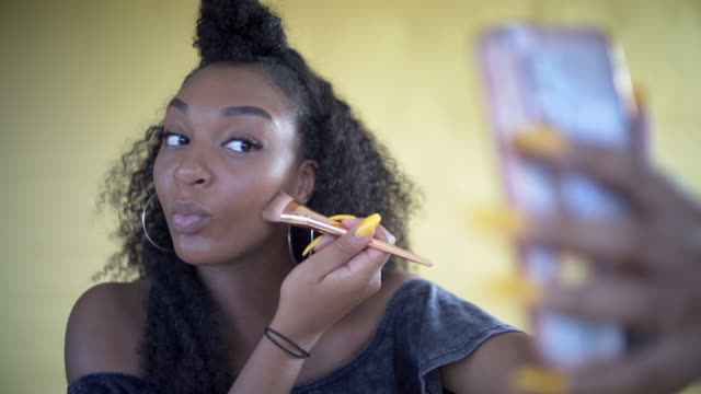 A Teenager doing her make-up.