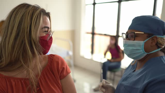 teenager girl being vaccinated - wearing face mask - epidemiology stock videos & royalty-free footage