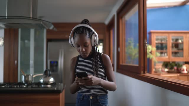 teenager girl listening to music and walking at home - weekend activities stock videos & royalty-free footage