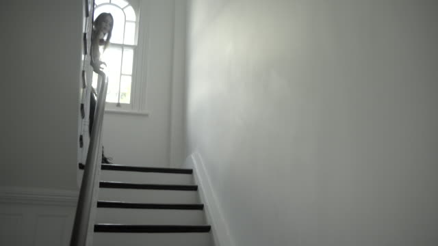 teenager girl on staircase with smart phone and headphones - staircase stock videos & royalty-free footage