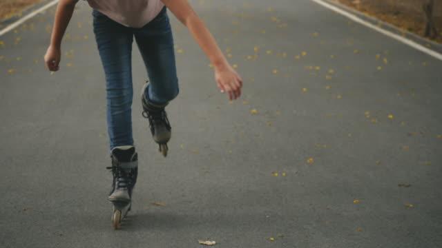 teenager girl playing roller skate - blade stock videos & royalty-free footage